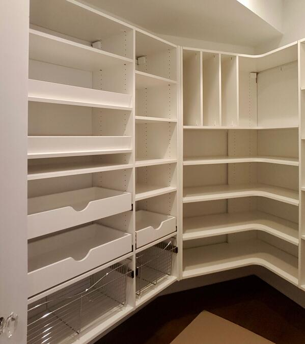 well-designed pantry with pullouts, wire baskets, corner radius shelves, and tray storage