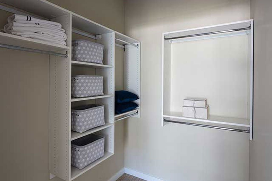 Commercial In-Unit Storage Solutions: Laminate Shelving with Linen Stacks by Innovative Closet Designs