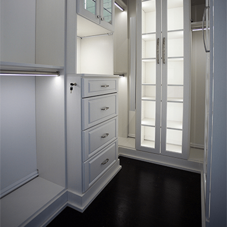 Innovative Closet Designs Custom Closet - Latitude North Walk in Closet with Square Style Hutch, LED Closet Lighting, Mullion Doors, Glass Shelves Decorative base and Crown Moulding