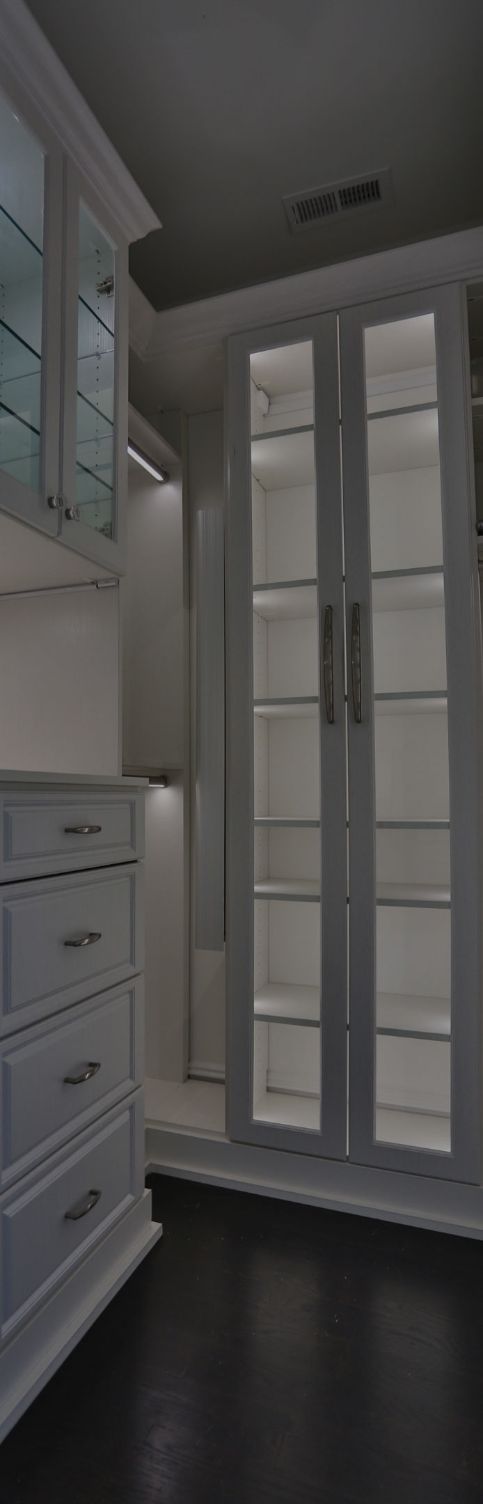 Innovative Closet Designs Custom Bedroom Closet - Latitude North Walk in Closet with Square Style Hutch, LED Closet Lighting, Mullion Doors, Glass Shelves Decorative base and Crown Moulding